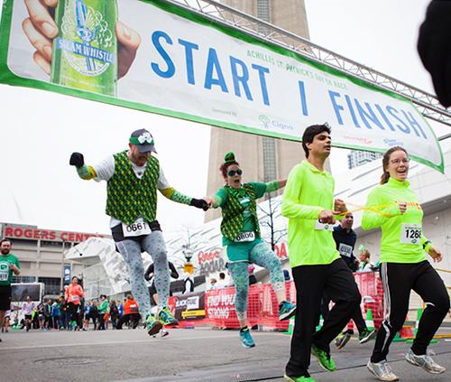 Athletes running across the finish line