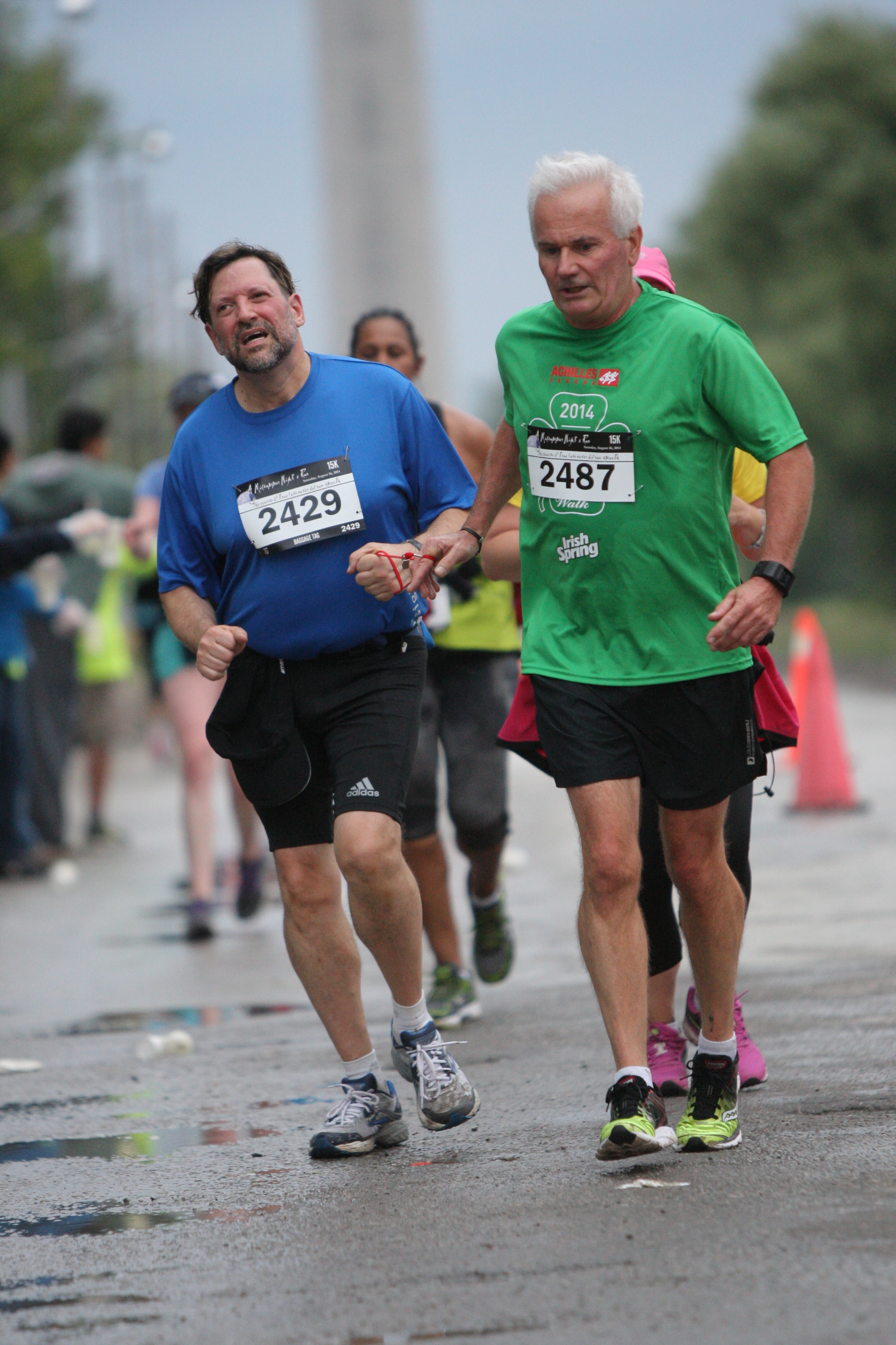 A volunteer and athlete running together